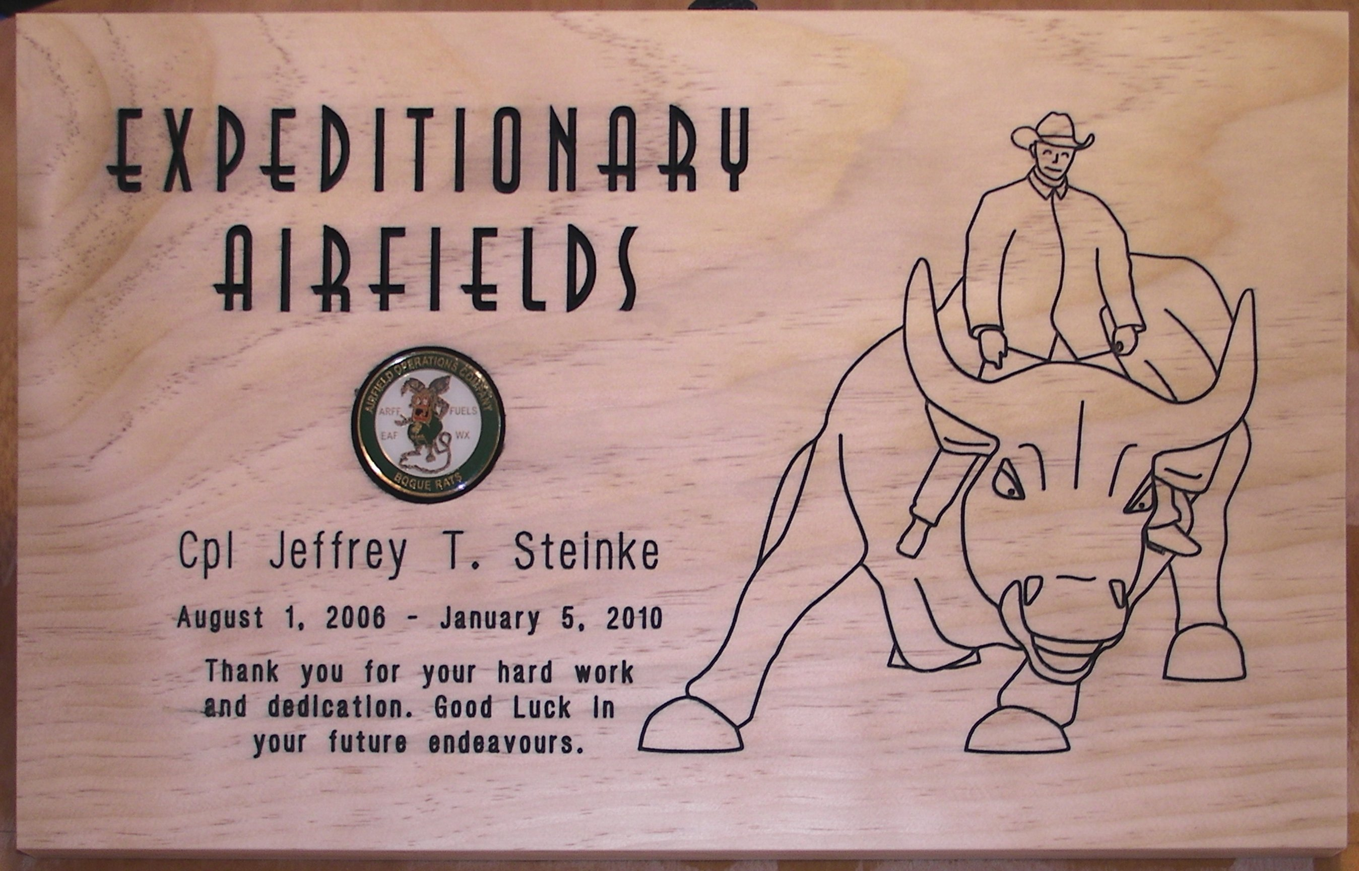 Another plaque with lineart from a picture of the Marine riding the Merrill Lynch Bull in New York City.